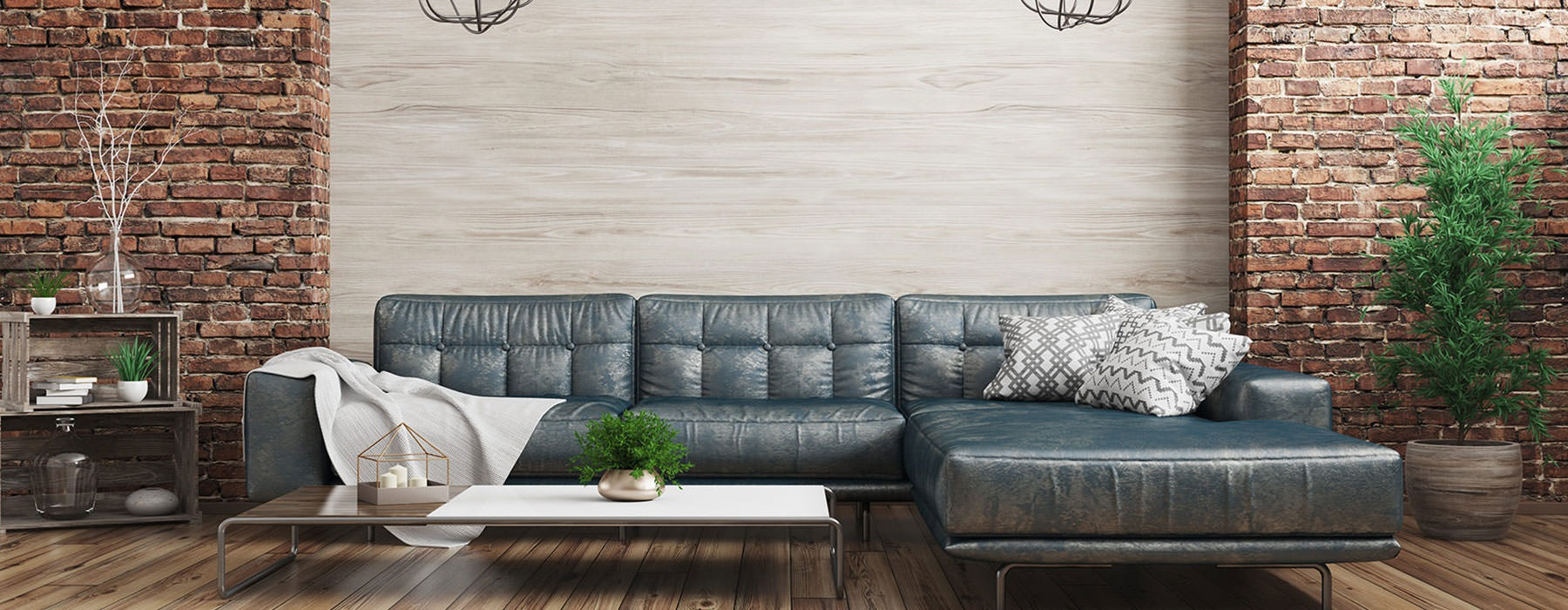 spacious couch in a large room with brick accents